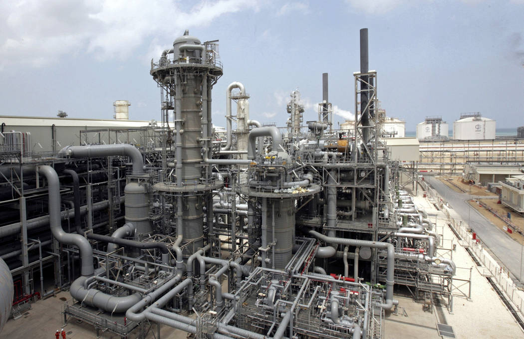 This April 4, 2009, file photo, shows a gas production facility at Ras Laffan, Qatar. The tiny, energy-rich Arab nation of Qatar announced on Monday, Dec. 3, 2018 it would withdraw from OPEC, mixi ...