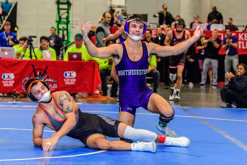 Northwestern's Sebastian Rivera rejoices after defeating Oregon State's Ronnie Bresser 6-4 in the 125-pounds finals of the 2018 Cliff Keen Invitational at the Las Vegas Convention Center Saturday, ...