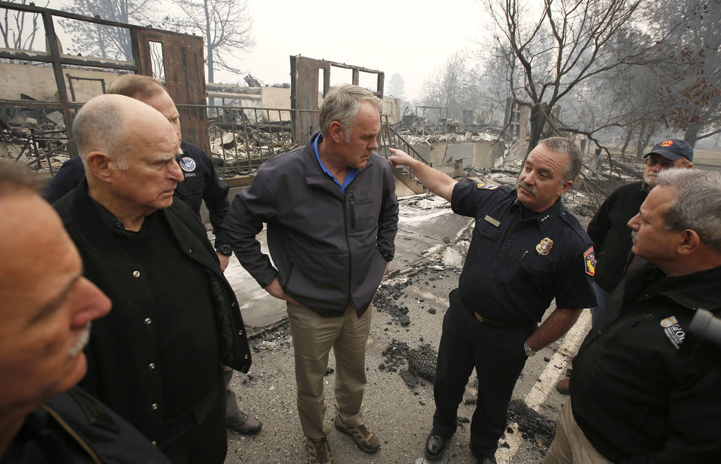 Scott Upton, right, the chief of the Northern Region for the California Department of Forestry and Fire Protection briefs California Gov. Jerry Brown, second from left, Federal Emergency Managemen ...