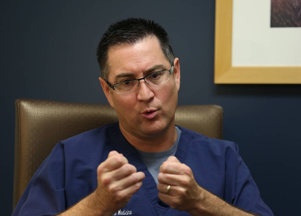 Dr. Oscar Ingaramo, right, Sunrise Children's Hospital PICU Medical director, speaks Monday, Dec. 3, 2018, during an interview with the Las Vegas Review-Journal as he talks about 1-year-old Roman ...
