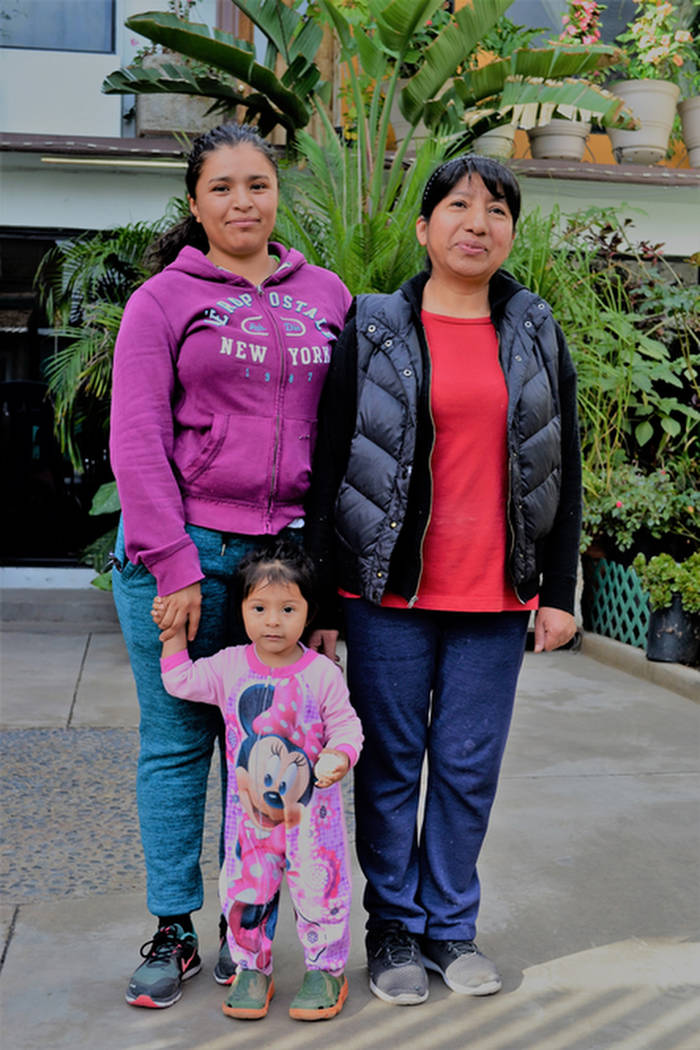 Three generations: Homeowner Irma Garcia, right, lives across the street from the El Barretal shelter. (Doug Kari/Special to Las Vegas Review-Journal)