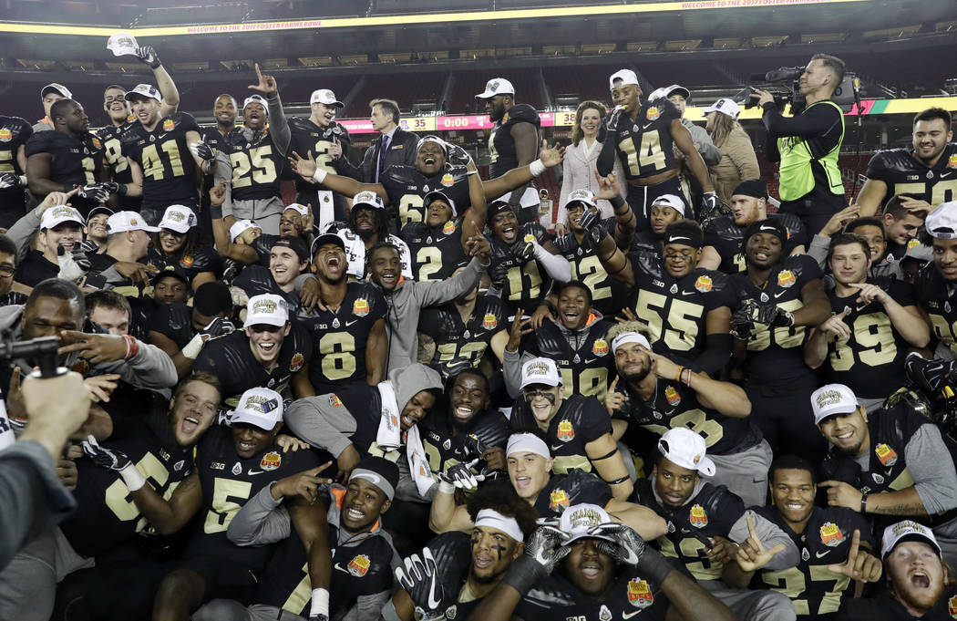 In this Dec. 27, 2017, file photo, Purdue players celebrate after a 38-35 win over Arizona during the Foster Farms Bowl NCAA college football game, in Santa Clara, Calif. (AP Photo/Marcio Jose San ...