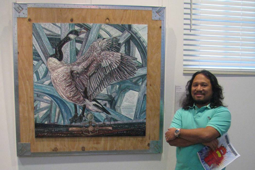 """Gig Depio stands before his work at the """"Aesthetics Primary."""" (Las Vegas Review-Journal file)"""