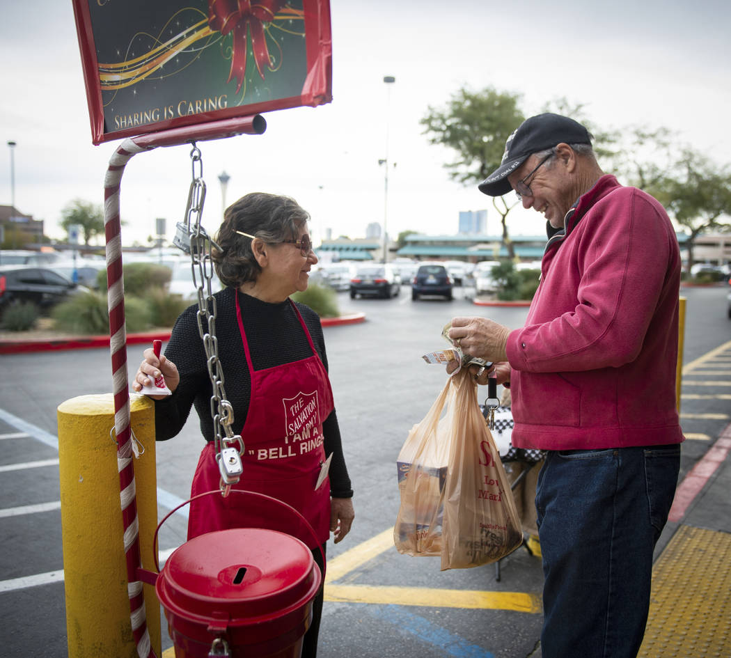 Esther Mowtelro, left, accepts a donation for the Salvation Army from David Wilhite in front of Smith's in Las Vegas, Wednesday, Dec. 5, 2018. Caroline Brehman/Las Vegas Review-Journal