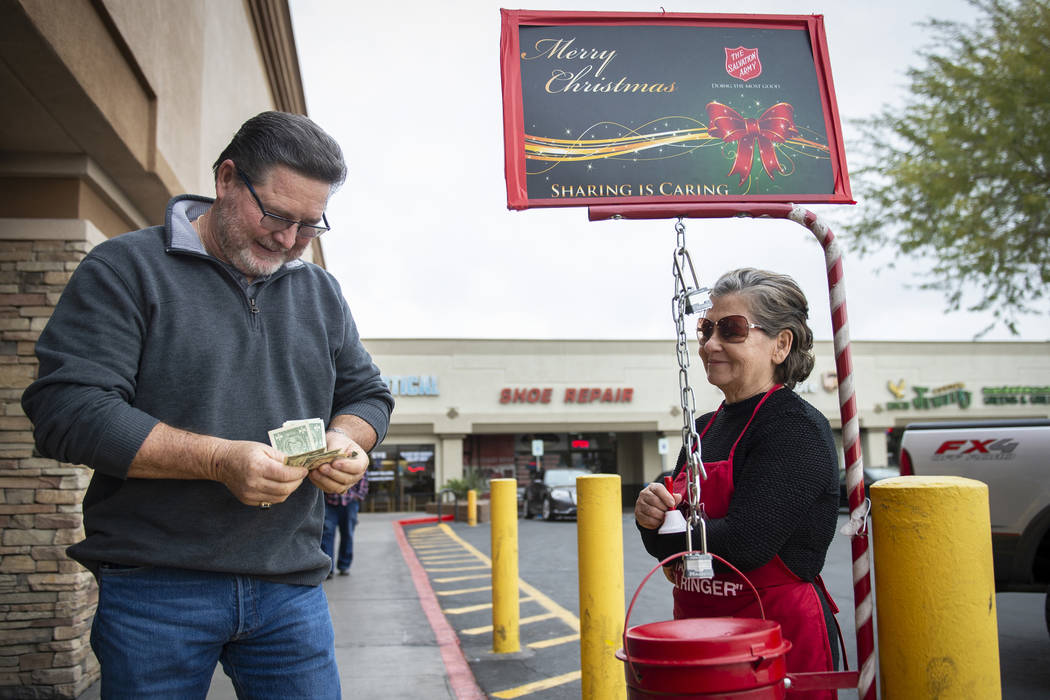 Esther Mowtelro accepts a donation for the Salvation Army from Tom Engel in front of Smith's in Las Vegas, Wednesday, Dec. 5, 2018. Caroline Brehman/Las Vegas Review-Journal