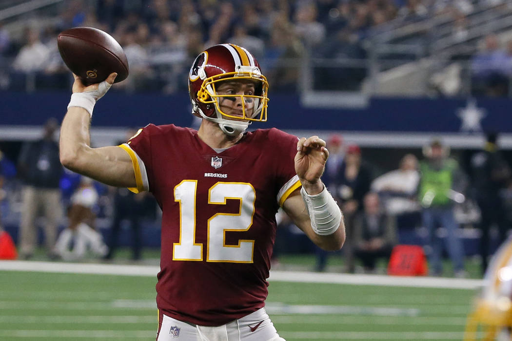In this Nov. 22, 2018, file photo, Washington Redskins quarterback Colt McCoy attempts to pass during the second half of an NFL football game against the Dallas Cowboys, in Arlington, Texas. (AP P ...