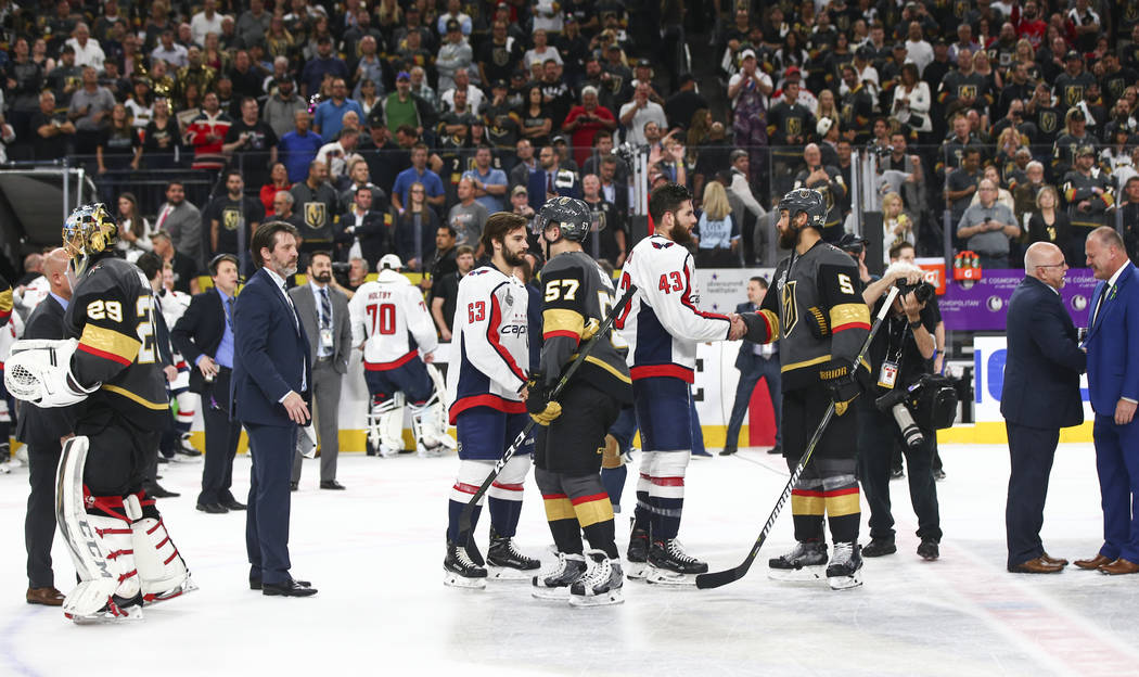 Washington Capitals players shake hands with Golden Knights players after the Capitals won Game 5 to win the Stanley Cup Final at T-Mobile Arena in Las Vegas on Thursday, June 7, 2018. Chase Steve ...