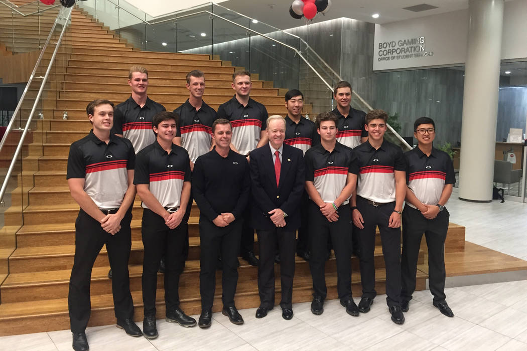 The UNLV men's golf team, head coach Dwaine Knight (center, red tie) and assistant coach Philip Rowe (left of Knight) are shown at the opening of the state-of-the-art Dwaine Knight Center for Golf ...