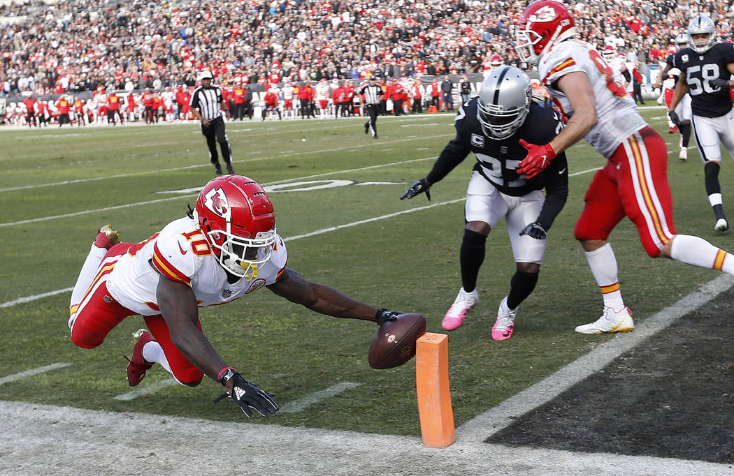 Kansas City Chiefs wide receiver Tyreek Hill (10) dives for the end zone against the Oakland Raiders during the second half of an NFL football game in Oakland, Calif., Sunday, Dec. 2, 2018. Hill d ...