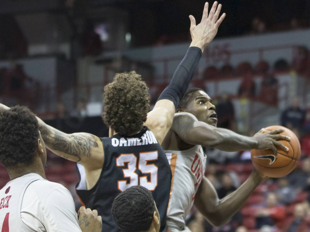 UNLV sophomore guard Amauri Hardy (3) slices to the rim past Pacific freshman forward Zach Cameron (35) in the second half on Tuesday, Nov. 20, 2018, at the Thomas & Mack Center, in Las Vegas. ...