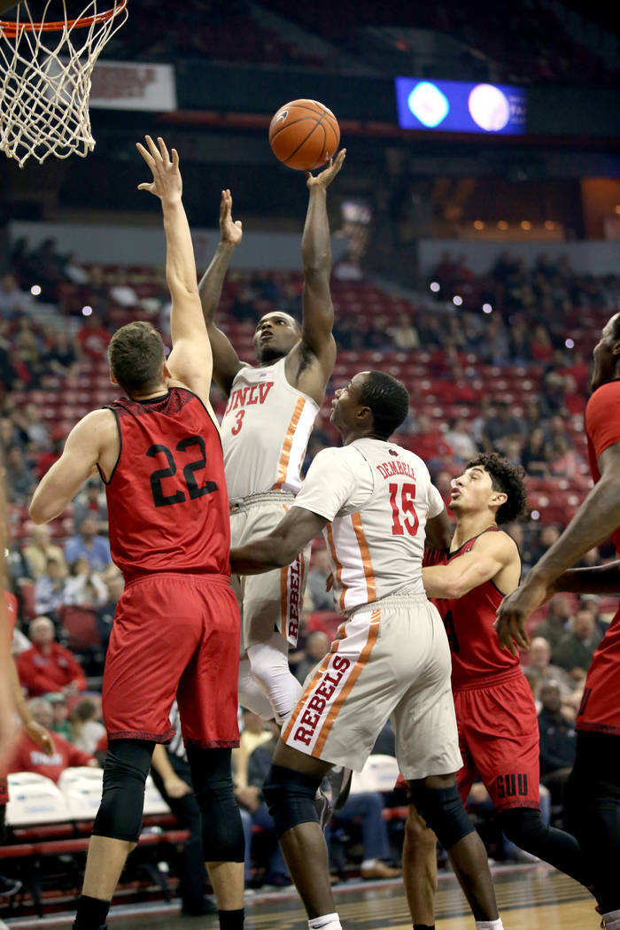 UNLV Rebels guard Amauri Hardy (3) shoots over Southern Utah Thunderbirds forward Ivan Madunic (22) in the first half of their NCAA basketball game at the Thomas & Mack Center in Las Vegas Fri ...