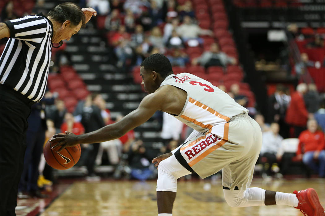 UNLV Rebels guard Amauri Hardy (3) saves the ball from going out of bounds against Valparaiso Crusaders during the second half of the basketball game at the Thomas & Mack Center in Las Vegas, ...