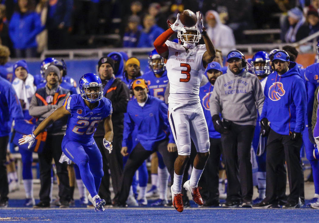 Fresno State wide receiver KeeSean Johnson (3) goes up for a reception in front of Boise State cornerback Avery Williams (26) during the first half of an NCAA college football game Friday, Nov. 9, ...