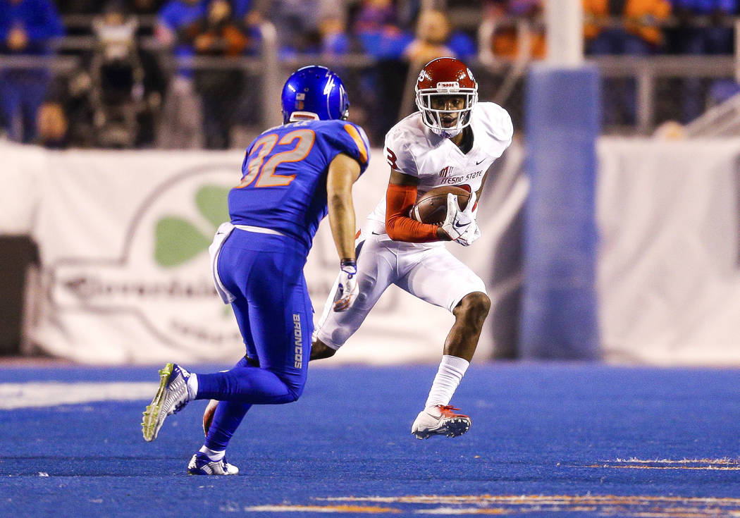 Fresno State wide receiver KeeSean Johnson (3) runs with the ball after a reception in front of Boise State safety Jordan Happle (32) in the second half of an NCAA college football game, Friday, N ...