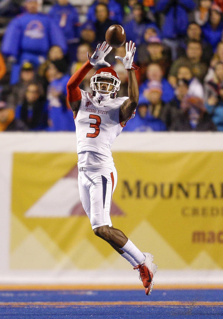 Fresno State wide receiver KeeSean Johnson (3) reaches for the ball on a reception against Boise State in the first half of an NCAA college football game, Friday, Nov. 9, 2018, in Boise, Idaho. Bo ...