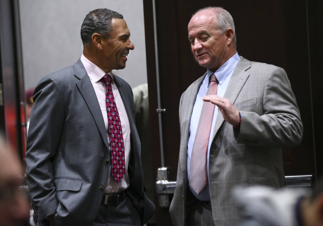 Arizona State head coach Herm Edwards, left, talks with Fresno State head coach Jeff Tedford before a press conference ahead of the Las Vegas Bowl at Hard Rock Hotel in Las Vegas on Friday, Dec. 1 ...