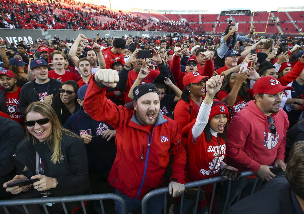 Fresno State fans celebrate their team's win over Arizona State of the Las Vegas Bowl football game at Sam Boyd Stadium in Las Vegas on Saturday, Dec. 15, 2018. Chase Stevens Las Vegas Review-Jour ...