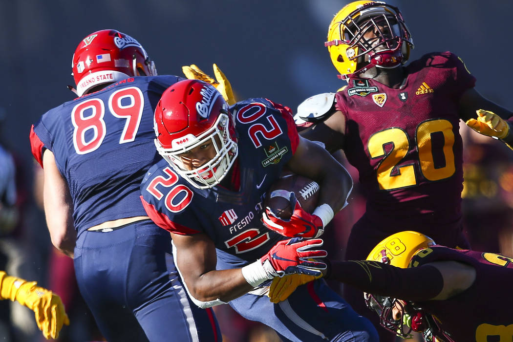 Fresno State running back Ronnie Rivers (20) runs the ball as Arizona State defensive back Demonte King tries to stop him during the first half of the Las Vegas Bowl football game at Sam Boyd Sta ...