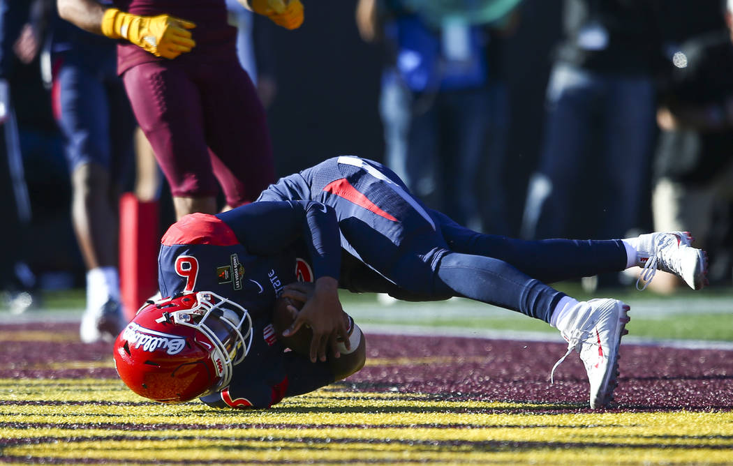 Fresno State quarterback Marcus McMaryion (6) scores a touchdown against Arizona State during the first half of the Las Vegas Bowl football game at Sam Boyd Stadium in Las Vegas on Saturday, Dec. ...