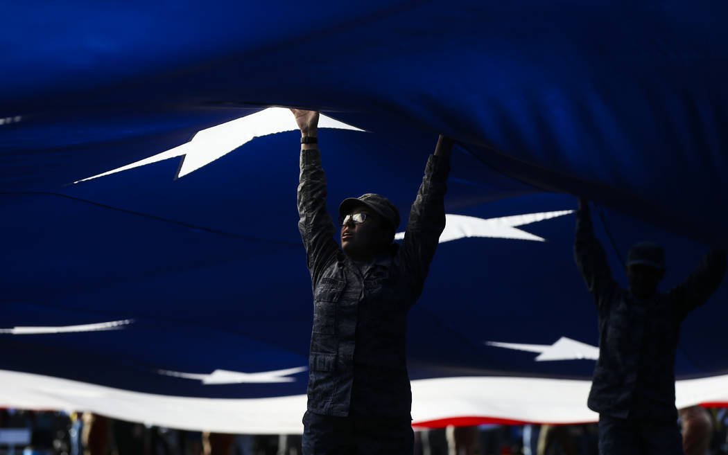 Members of the Air Force display a large flag on the field before the start of the Las Vegas Bowl football game at Sam Boyd Stadium in Las Vegas on Saturday, Dec. 15, 2018. Chase Stevens Las Vegas ...