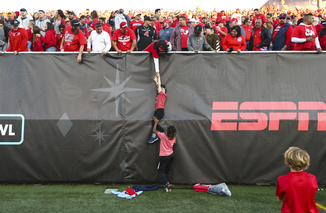 A child is lowered to the field after Fresno State defeated Arizona State in the Las Vegas Bowl football game at Sam Boyd Stadium in Las Vegas on Saturday, Dec. 15, 2018. Chase Stevens Las Vegas R ...