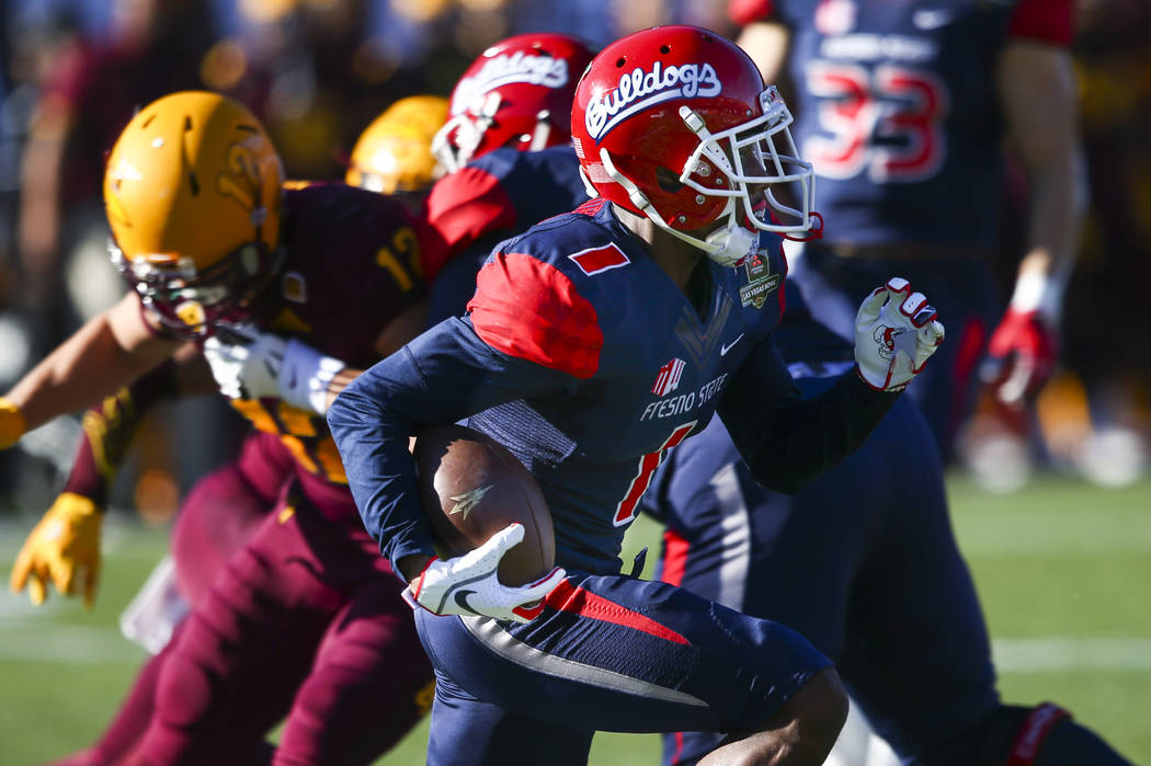 Fresno State wide receiver Jamire Jordan (1) runs the ball against Arizona State during the first half of the Las Vegas Bowl football game at Sam Boyd Stadium in Las Vegas on Saturday, Dec. 15, 20 ...
