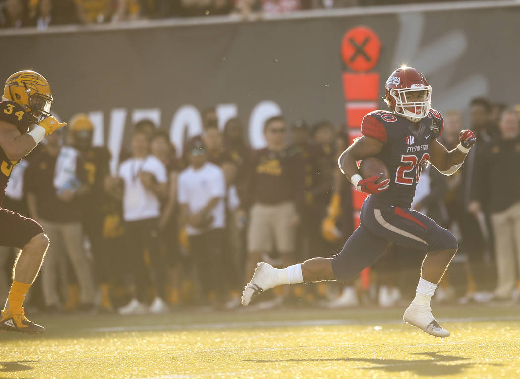 Fresno State running back Ronnie Rivers (20) runs the ball past Arizona State linebacker Kyle Soelle (34) on his way to a score a touchdown during the second half of the Las Vegas Bowl football ga ...
