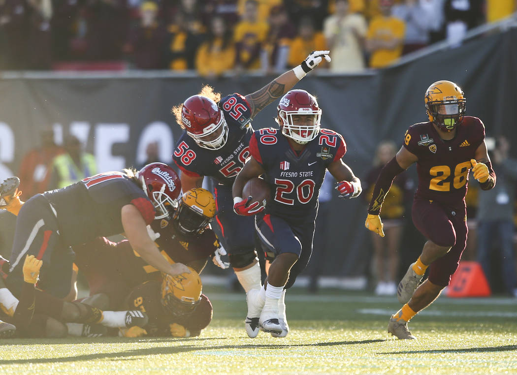 Fresno State running back Ronnie Rivers (20) runs the ball past Arizona State defensive back Demonte King (28) on his way to a score a touchdown during the second half of the Las Vegas Bowl footba ...
