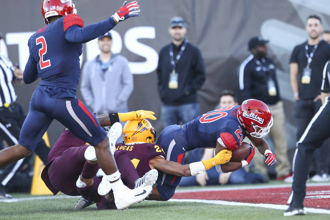 Fresno State running back Ronnie Rivers (20) scores a touchdown against Arizona State during the second half of the Las Vegas Bowl football game at Sam Boyd Stadium in Las Vegas on Saturday, Dec. ...