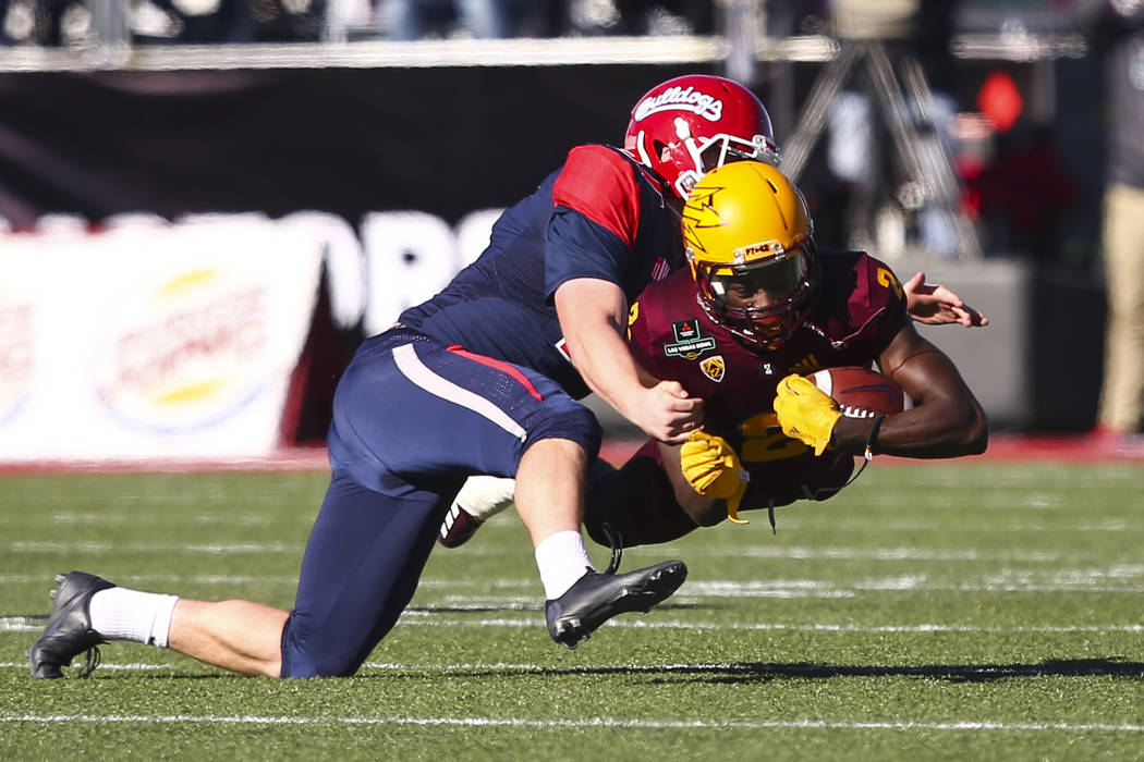 Fresno State place kicker Asa Fuller (37) tackles Arizona State wide receiver Brandon Aiyuk (2) during the first half of the Las Vegas Bowl football game at Sam Boyd Stadium in Las Vegas on Saturd ...