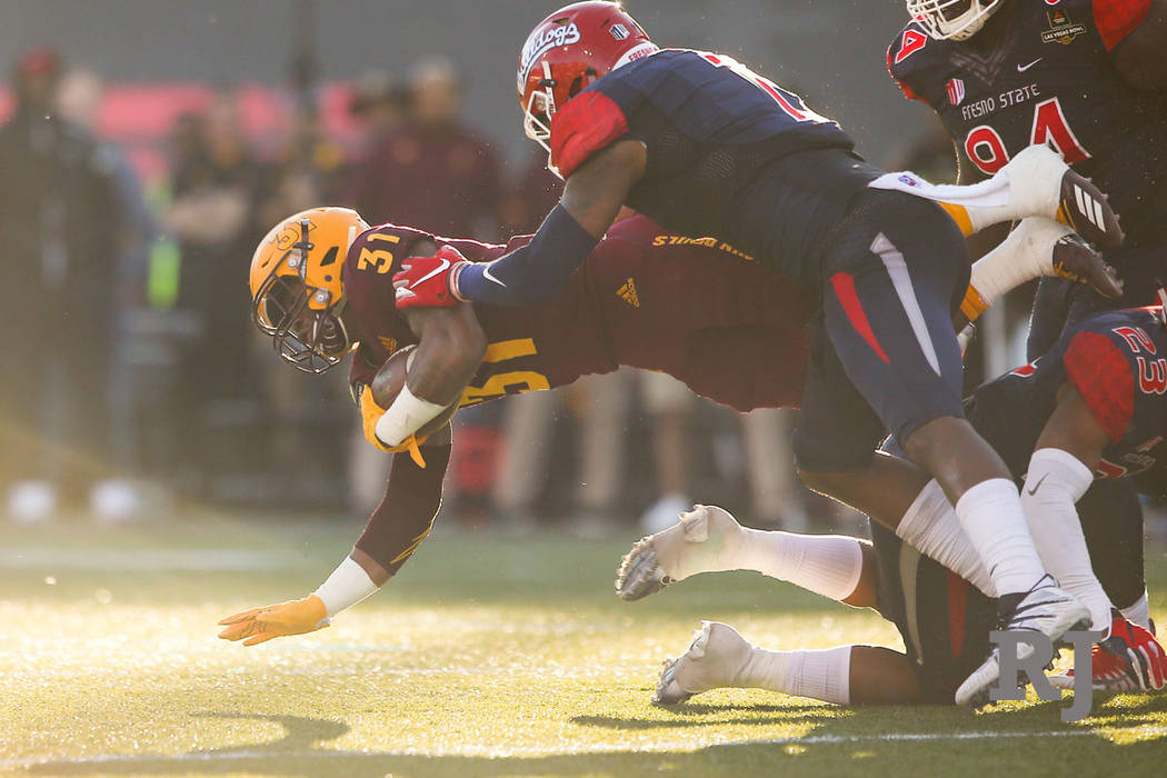 Arizona State running back Isaiah Floyd (31) is tackled by Fresno State linebacker James Bailey (7) during the second half of the Las Vegas Bowl football game at Sam Boyd Stadium in Las Vegas on S ...