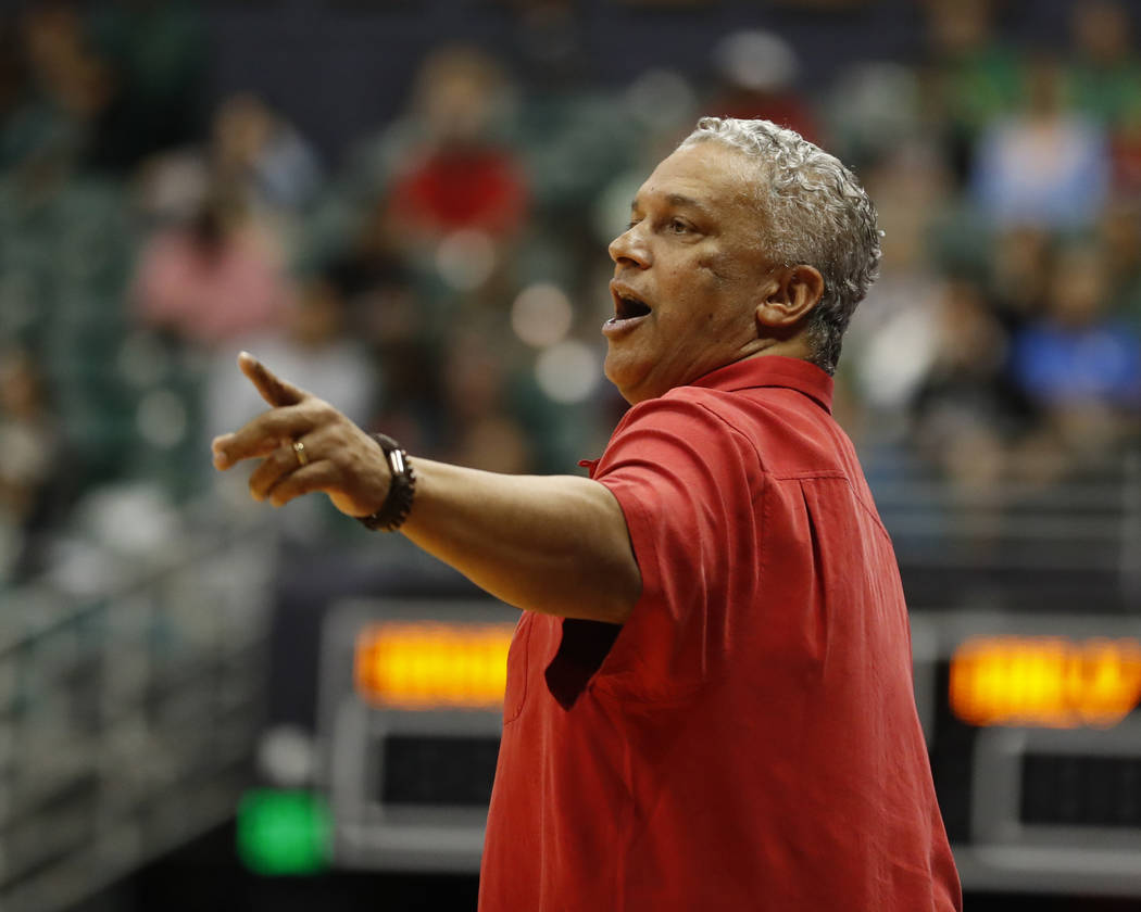 UNLV head coach Marvin Menzies signals to his team as they take on Hawaii during the first half of an NCAA college basketball game at the Diamond Head Classic, Saturday, Dec. 22, 2018, in Honolulu ...