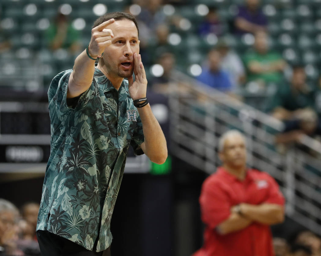 Hawaii head coach Eran Ganot yells direction at his team as they take on UNLV during the first half of an NCAA college basketball game at the Diamond Head Classic, Saturday, Dec. 22, 2018, in Hono ...