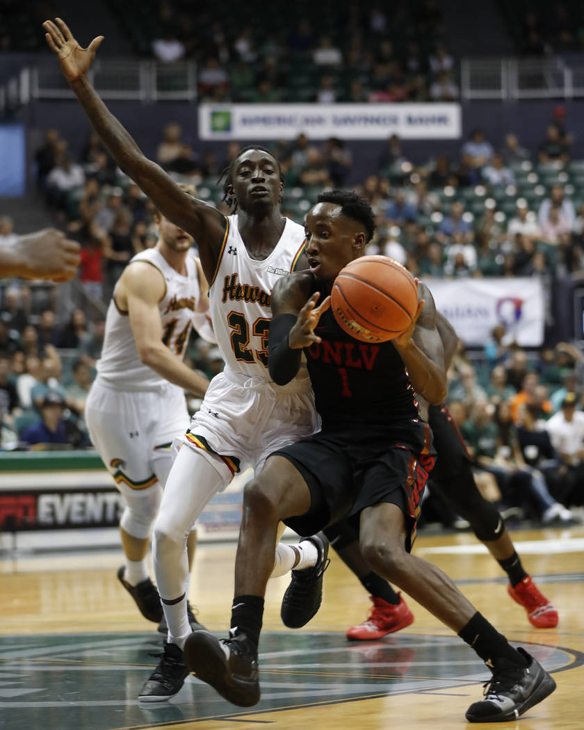 UNLV guard Kris Clyburn (1) is defended by Hawaii guard Sheriff Drammeh (23) during the second half of an NCAA college basketball game at the Diamond Head Classic, Saturday, Dec. 22, 2018, in Hono ...