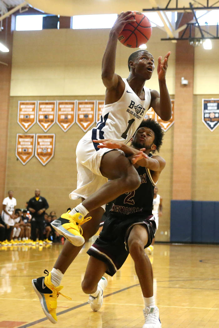 Democracy Prep's Najeeb Muhammad (1) goes up for a shot against Cimarron-Memorial's Isaiah Armstrong (2) in their basketball game at Legacy High School in North Las Vegas, Friday, Nov. 30, 2018. E ...