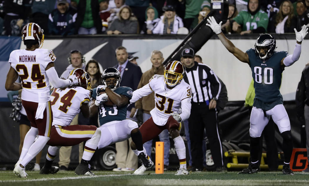 Philadelphia Eagles' Darren Sproles (43) scores a touchdown against Washington Redskins' Fabian Moreau (31), Mason Foster (54) and Josh Norman (24) during the first half of an NFL football game, M ...