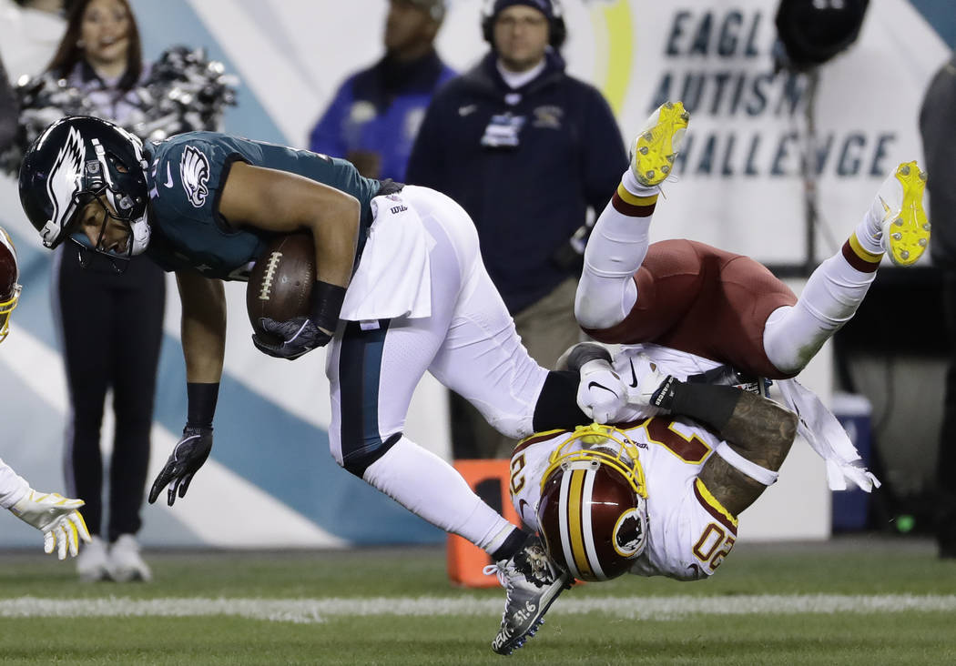 Philadelphia Eagles' Golden Tate (19) is tackled by Washington Redskins' Ha Ha Clinton-Dix (20) during the second half of an NFL football game, Monday, Dec. 3, 2018, in Philadelphia. (AP Photo/Mic ...