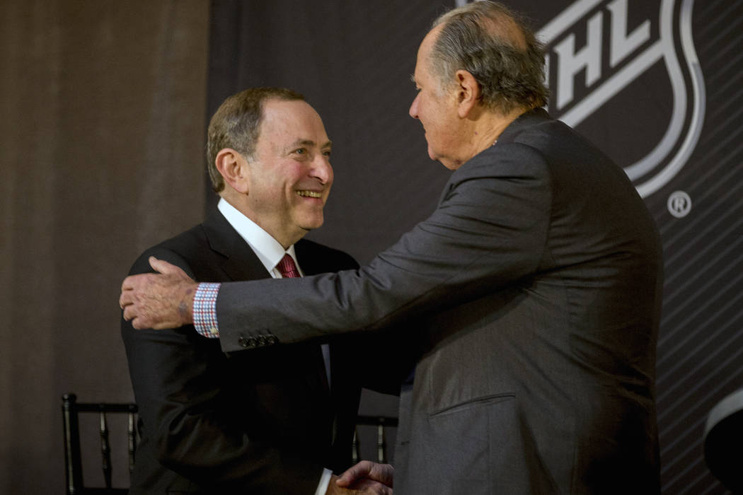 NHL commissioner Gary Bettman, left, shakes hands with Seattle Hockey Partners majority owner David Bonderman after the announcement by the National Hockey League Board of Governors to name Seattl ...