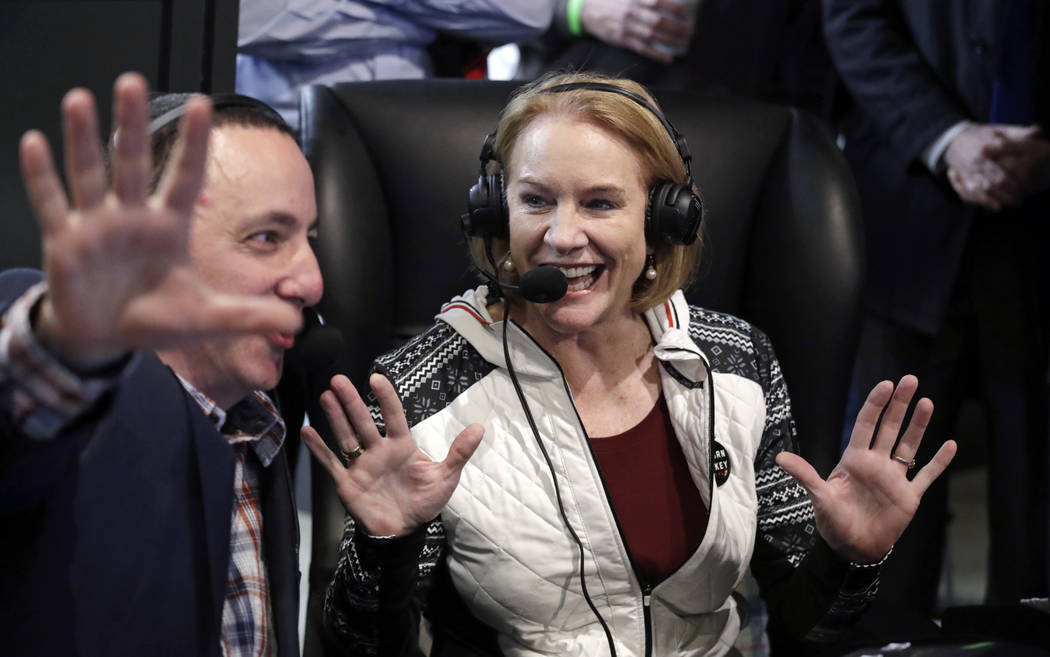 Seattle Mayor Jenny Durkan smiles as she is interviewed on a radio station sports broadcast before the announcement of a new NHL hockey team in Seattle at a celebratory party Tuesday, Dec. 4, 2018 ...