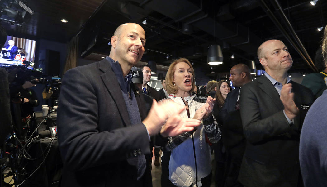 Seattle Mayor Jenny Durkan, center, cheers the announcement of a new NHL hockey team in Seattle with brothers Ted Ackerley, left, and Chris Ackerley at a celebratory party Tuesday, Dec. 4, 2018, i ...