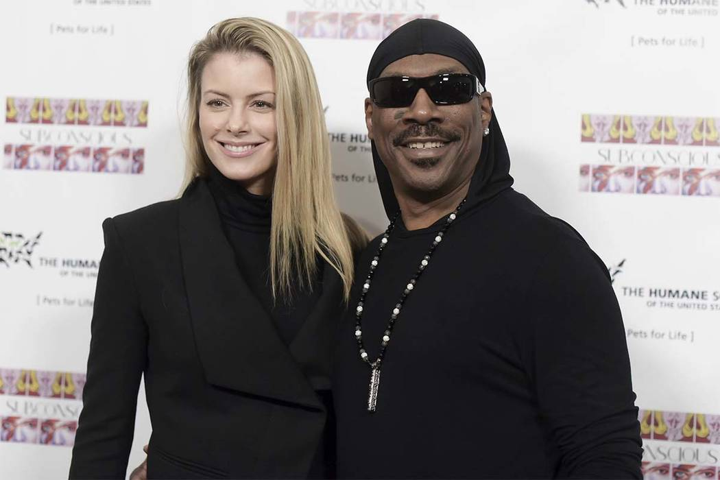 "In this Nov. 20, 2016, file photo, Paige Butcher, left, and Eddie Murphy attend ""Subconscious"" by Bria Murphy Gallery Opening at Lace Gallery in Los Angeles. (Richard Shotwell/Invision/AP, File)"