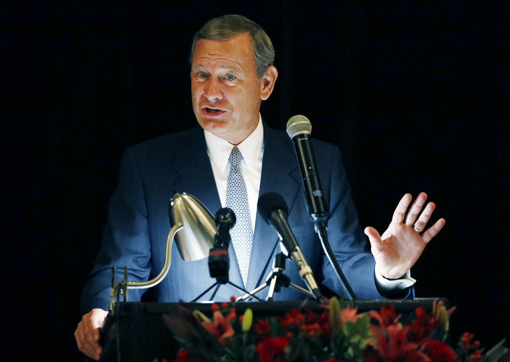 FILE - In this Sept. 27, 2017 file photo, Chief Justice John Roberts speaks during the Bicentennial of Mississippi's Judiciary and Legal Profession Banquet in Jackson, Miss. Roberts is pushing bac ...