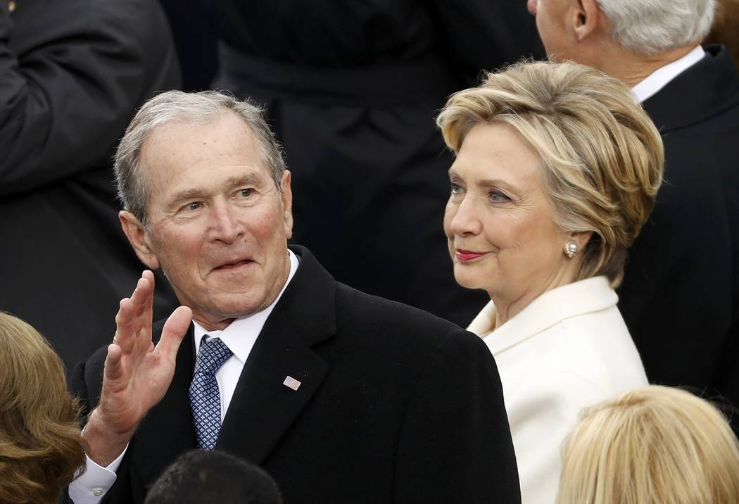 George W. Bush and Hillary Clinton attend the inauguration ceremonies to swear in Donald Trump as the 45th president of the United States at the U.S. Capitol in Washington, U.S., January 20, 2017. ...