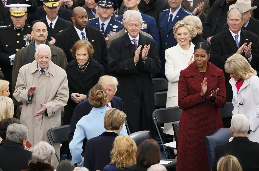 President-Elect Donald Trump kisses his wife, Melania, in front of former presidents Jimmy Carter, Bill Clinton and George W Bush at the inauguration ceremonies swearing in Donald Trump as the 45t ...