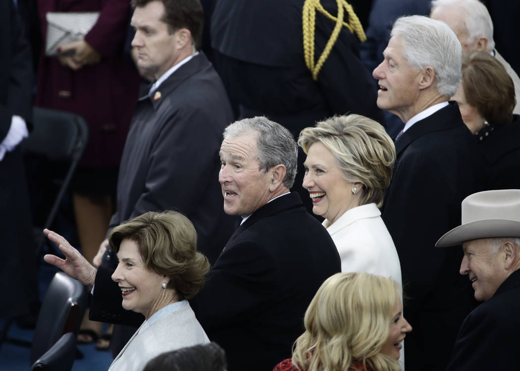Former President George W. Bush, left, his wife Laura, Former Secretary of State Hillary Clinton and Former President Bill Clinton wait for the 58th Presidential Inauguration for President-elect D ...
