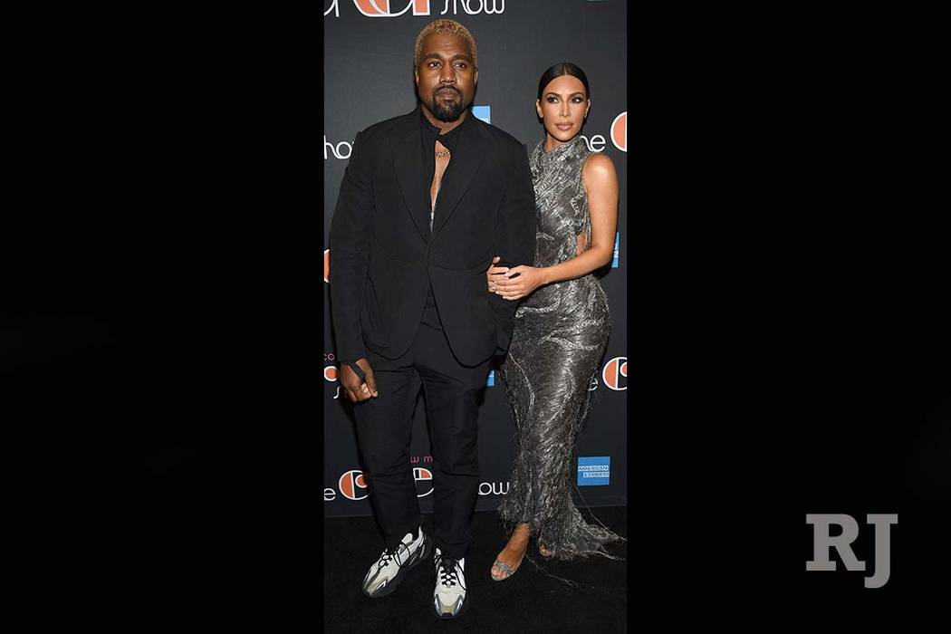 "Kanye West, left, and Kim Kardashian West attend ""The Cher Show"" Broadway musical opening night at the Neil Simon Theatre on Monday, Dec. 3, 2018, in New York. (Evan Agostini/Invision/AP)"