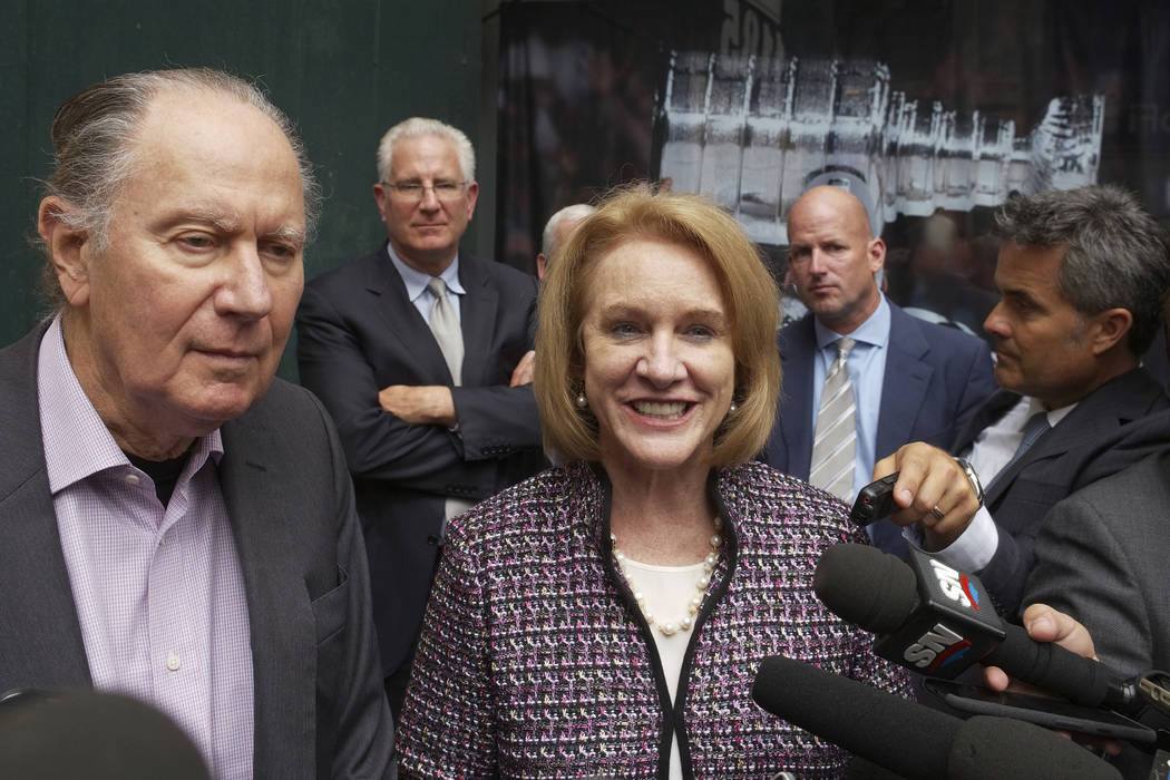 Seattle Hockey Partners David Bonderman, left, and Seattle Mayor Jenny Durkan talk to the media as they leave a meeting at National Hockey League headquarters, in New York on Oct. 2, 2018. (AP Pho ...