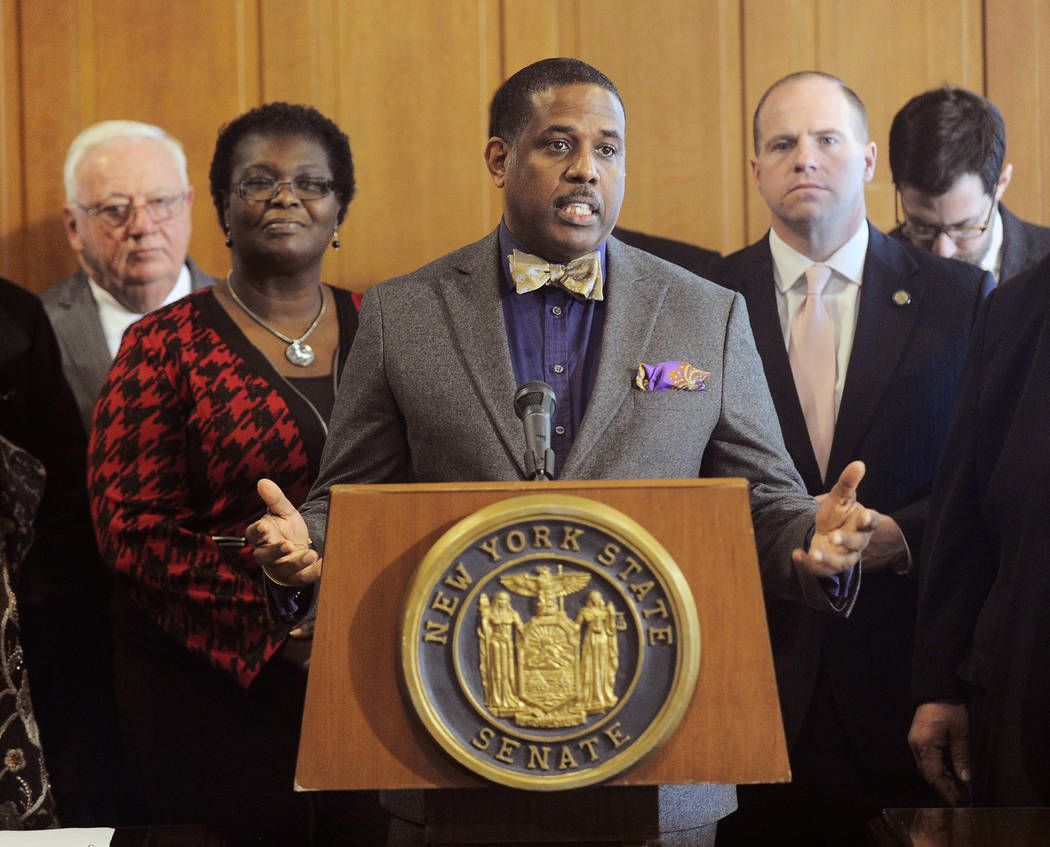 FILE- In this Feb. 6, 2017, file photo, Sen. Kevin Parker, D- Brooklyn, stands at the podium, flanked by Senate members during a news conference at the Capitol in Albany, N.Y. Parker wants to requ ...