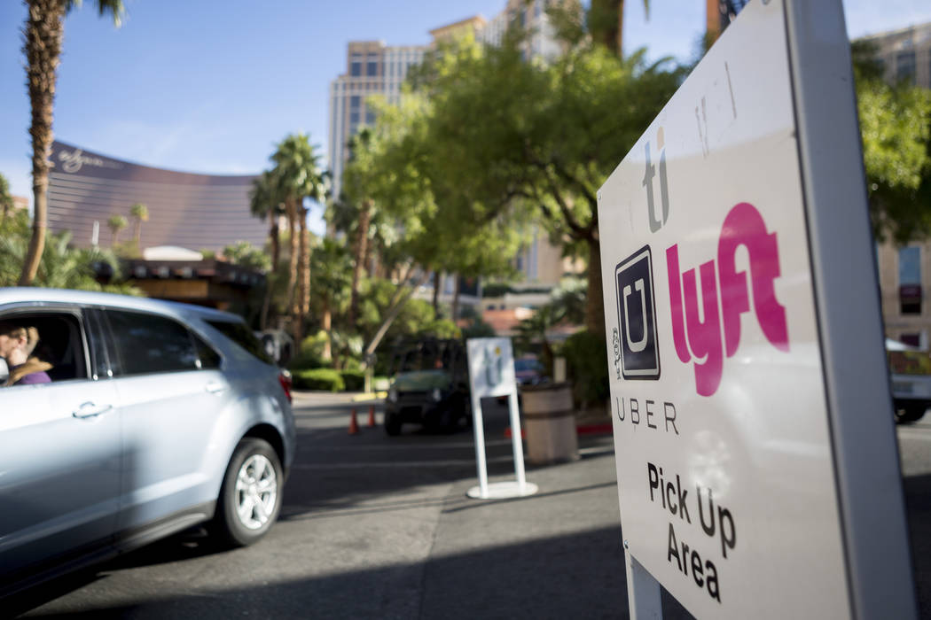 Lyft driver Laury Stoeser drives to the Caesars Palace ride-hailing pick up location in Las Vegas on Nov. 29, 2017. Elizabeth Brumley Las Vegas Review-Journal @EliPagePhoto