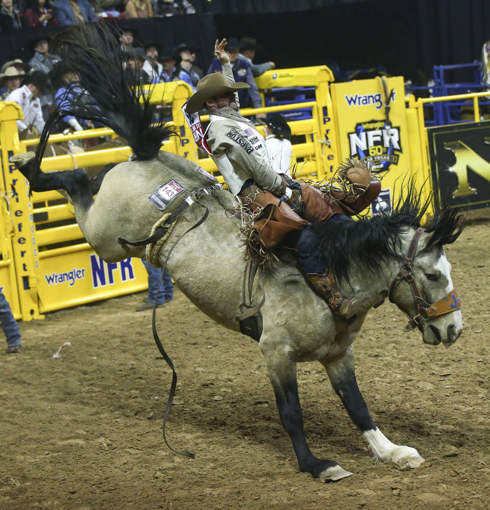 """Mason Clements of Springville, Utah rides """"Colorado Bulldog"""" while competing in bareback riding during the opening night of the National Finals Rodeo at the Thomas & Mack Center in L ..."""